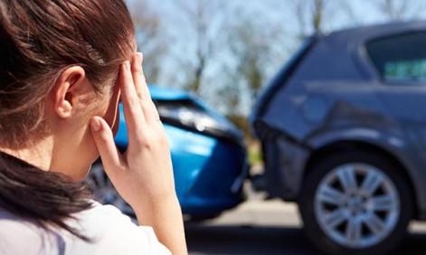 woman-looks-at-car-after-crash1